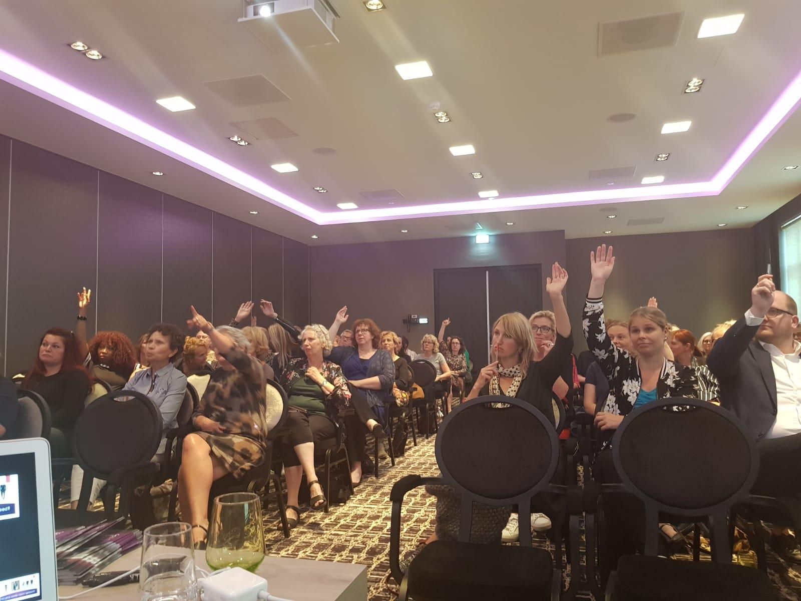 Presentatie 'De kracht van kleding' voor GIMD